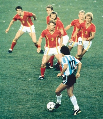 As this Argentinian legend prepared to rumble through this gauntlet of Belgium defenders, it became clear Diego Maradona was no match for mere mortals.    Despite the splitting of the opposing wall, all eyes remained focused on one man.