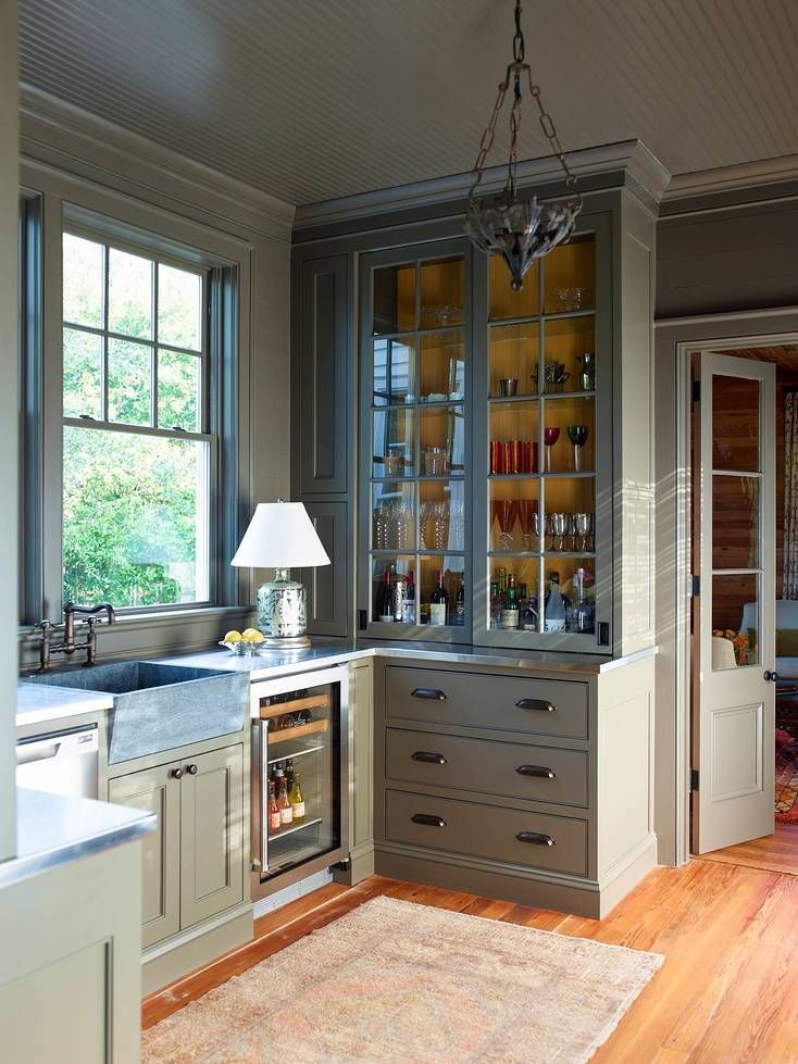 Photo Credit Eric Piasecki Gorgeous Sage Kitchen With Glass