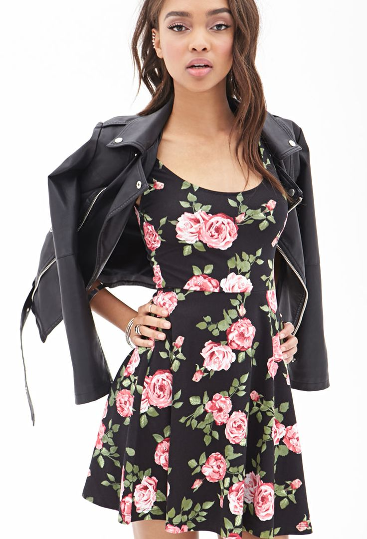 I love this whole outfit. The leather jacket ties in perfectly with the black background of the roses