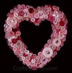 DIY an easy  Valentine Day Button Wreath ....I am in love with this wreath!! The pink definitely has something to do with it! :)