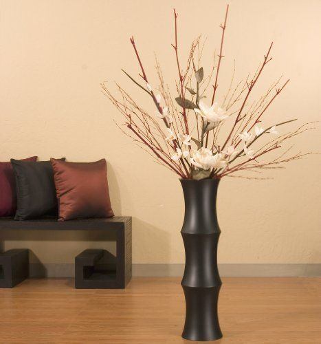 """Shopping The Globe Tall Mango Wood Scalloped Floor Vase, 27 inch - Black Matte by Shopping The Globe. $59.99. Hand-turning and hand-lathing techniques make each vase a unique decorative accent. Available in medium Oak, Black or Dark Cherry with swirling accent grain. Perfect for arrangement of tall branches or dried floral. Crafted from solid mango wood by artisans in Thailand. Mango wood vase measures 27"""" tall x 7"""" diameter at its widest point.. This decorative..."""