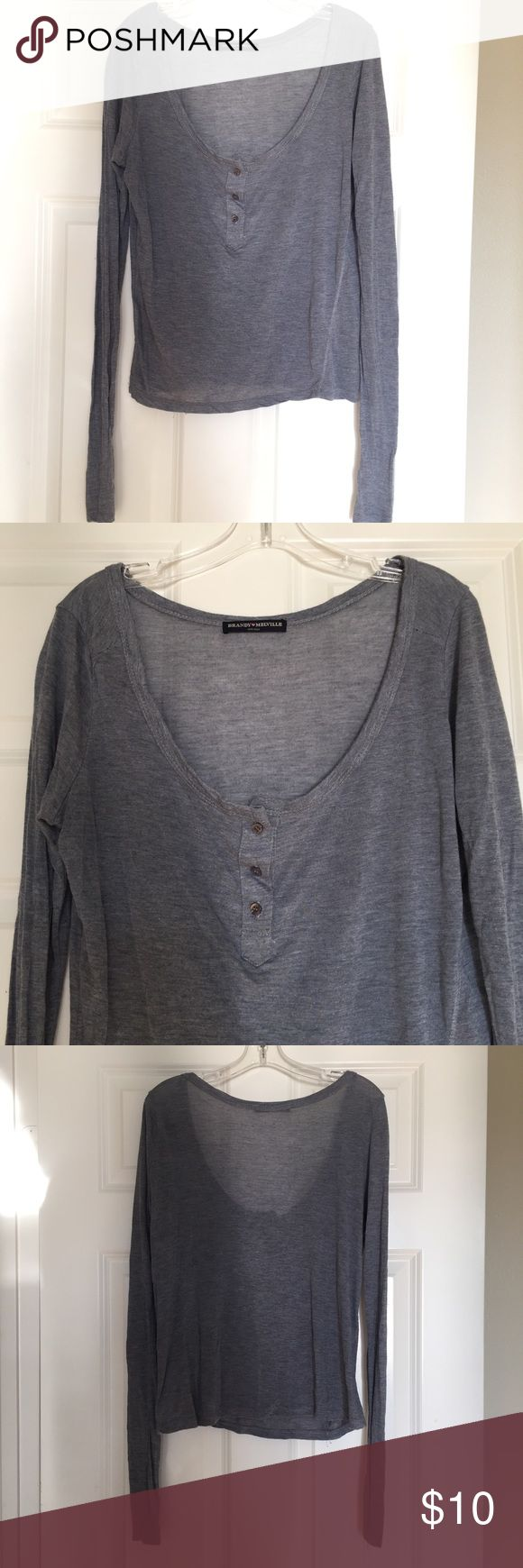 long sleeve Brandy Melville top This is a blueish/grey scoop neck long sleeve. It has three cute buttons. Very thin fabric. Very cozy fabric. Brandy Melville Tops Tees - Long Sleeve