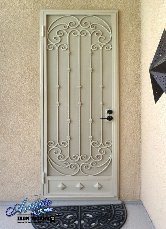 Scrolled wrought iron screen security door with kick plate