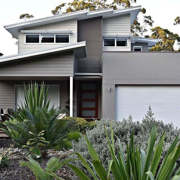 This lush greenery is the perfect foreground to the muted grey tones of this impressive design featuring Scyon. See more design ideas here: http://scyon.com.au/design-ideas