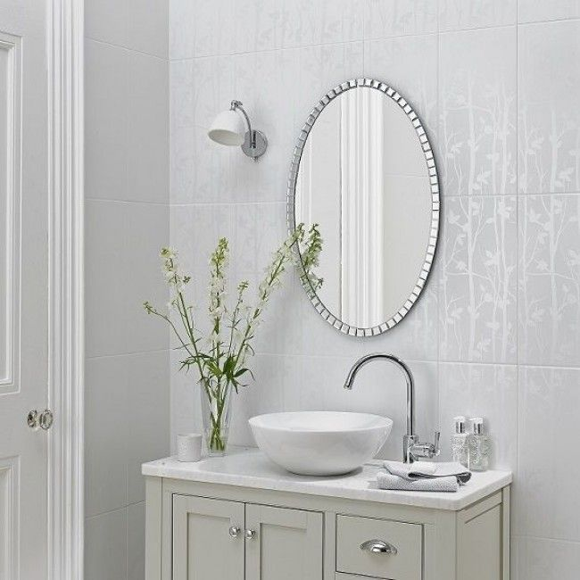 Laura Ashley Cottonwood Feature Tile 250x500 This unique looking feature wall tile with its leaf detailing (LA51454) fits in perfectly with any all-white design scheme or with the other tiles in the Laura Ashley Cottonwood range. Featuring a subtle leaf design, this high quality satin finished tile is suitable for use across the whole house, including kitchens, but is ideal when used to create a relaxing, elegant look to your bathroom walls.
