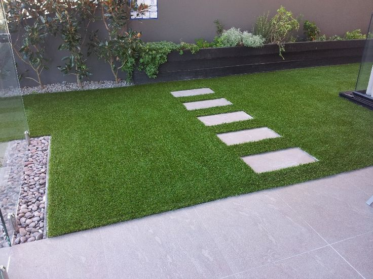 Astro turf shaped around pavers - fake grass for domestic lawns
