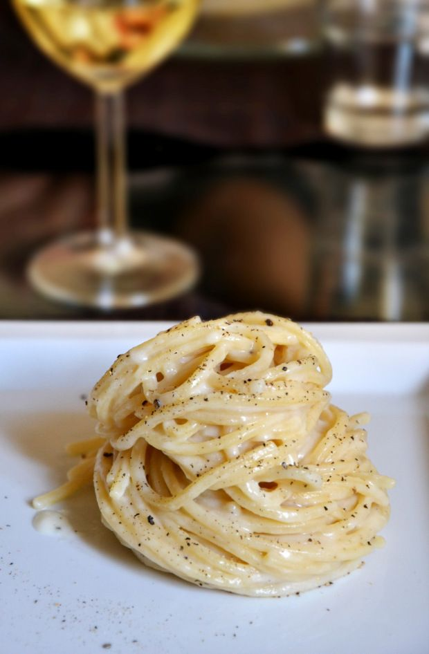 Cacio e Pepe, one of Rome's traditional pasta dishes (the others are Carbonara, Matriciana, and Gricia).  Since Cacio e Pepe has only three main ingredients -Pecorino Romano cheese, black pepper and pasta-, it might seem an easy recipe to make – but it isn't.