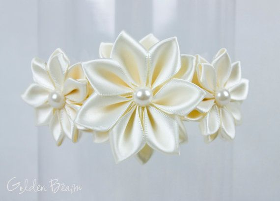 3 Gorgeous ivory flowers made of satin ribbon with half pearls in the centre, on a skinny ivory nylon headband. The headband is small enough to fit a