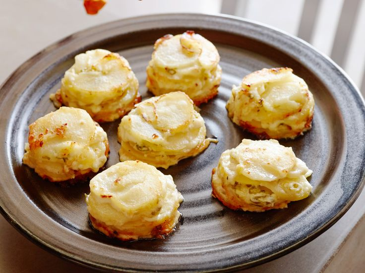 Individual Potato Gratins : Melissa layers sliced russet potatoes, Swiss cheese and chopped green onion into muffin cups for easier serving, portion control and faster cooking time. Before baking, top each gratin cup with a splash of heavy cream for that rich, signature flavor.