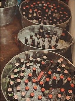 Galvanized tubs: A practical way to store beer and other bottles at a rustic themed, outdoor or summer wedding. You can stock up on them here.