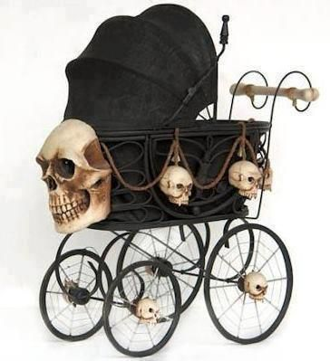Goth baby stroller - reminds me of something one of Tim Burton's characters would use!