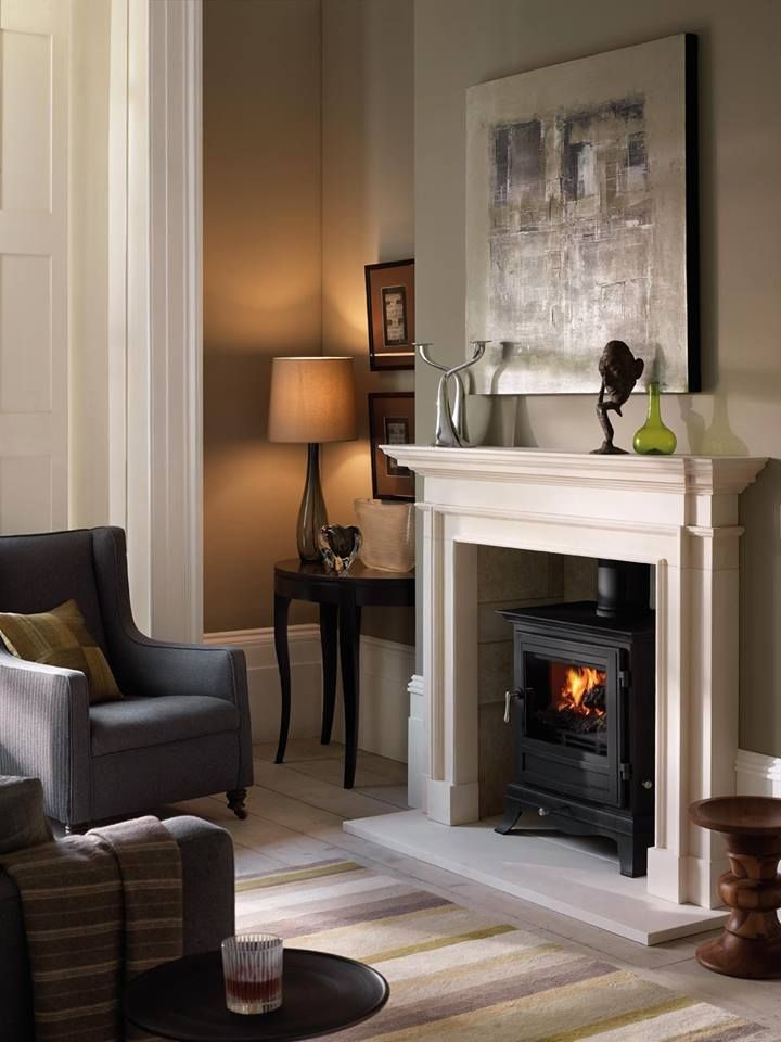 Chesney's Salisbury wood burning stove in black anthracite with Burlington limestone surround