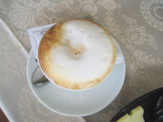 Cappucino in Italy...the real thing. No cinnamon dusting, no hearts or swirls. Just good strong espresso and steamed milk. Really wakes you up!