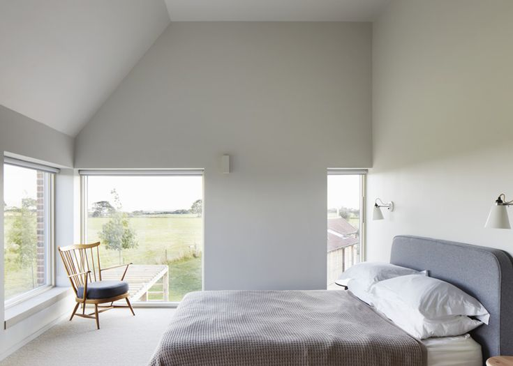 LUCY MASTEN | Long Farm / Like the master bedroom of the 'Y House' this bedroom has an angled roof, and windows from the side of the bed, that illuminate the room with natural lighting.