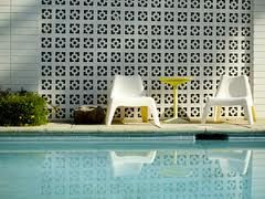 Decorative concrete masonry block wall, pool side. Love!