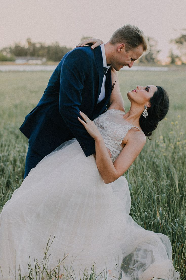 Here's a romantic wedding photo idea for brides and grooms. Her stunning gown was designed by Cape Town designer Janita Toerien. To see more of this gorgeous wedding at Vondeling go to michelledt.com