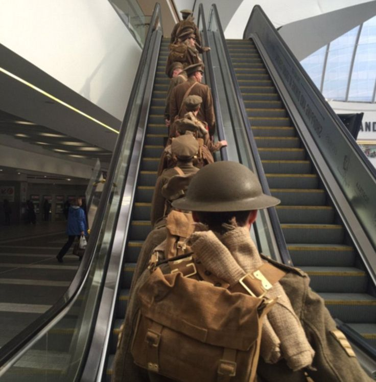 A reminder of real sacrifice and integrity': Commuters moved to tears as actors dressed as fallen soldiers silently hand out cards carrying the names of those killed at the Battle of the Somme. - Mar Dixon took this moving photograph at Birmingham New Street and wrote: 'I can't tell yyou how moving it is seeing them leave - probably knowing they aren't coming back' - 1st July 2016
