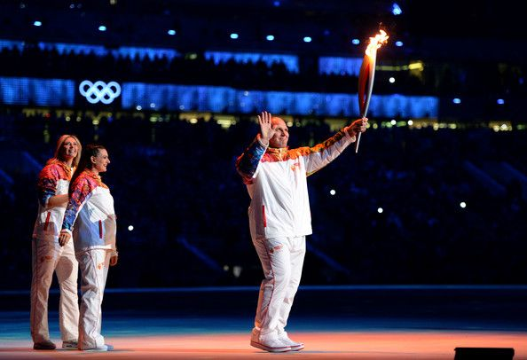 Maria Sharapova - Winter Olympic Games Opening Ceremony.  Russian former wrestler Alexander Karelin holds up the Olympic torch next to Russian pole vaulter Yelena Isinbayeva (2nd L) and Russian tennis player Maria Sharapova (L) during the opening ceremony of the Sochi 2014 Winter Olympics at the Fisht Olympic Stadium on February 7, 2014, in Sochi, Russia.