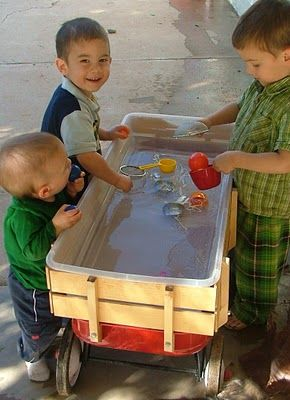When the weather is good, water play can be easy to introduce to your outdoor Montessori space. Place a large tupperware tub in the back of a wagon. The lid will protect the activities, provide a place to clean up other summer outdoor works, and keep water clean longer. It can be rolled away to storage easily.