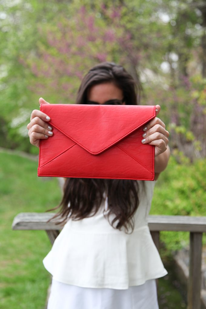 Nice red clutch purse. Look closely!.