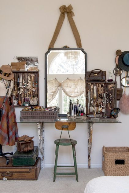 Eclectic Bedroom by Adrienne DeRosa - jewelry out as display in old boxes or on dummy, suitcases,. wooden shoe forms