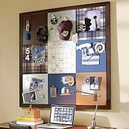 super easy way to organize & decorate at the same time.  Just cover corkboard tiles with fabric!