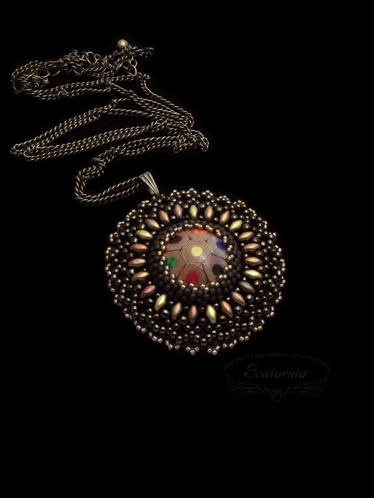 Bead embroidery pendant with a cabochon made from crayons