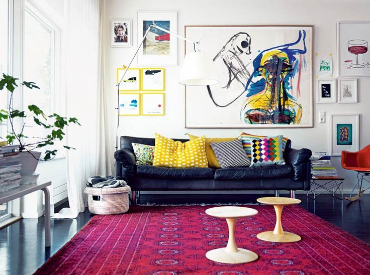 Gallery wall, navy leather, fun throw pillows