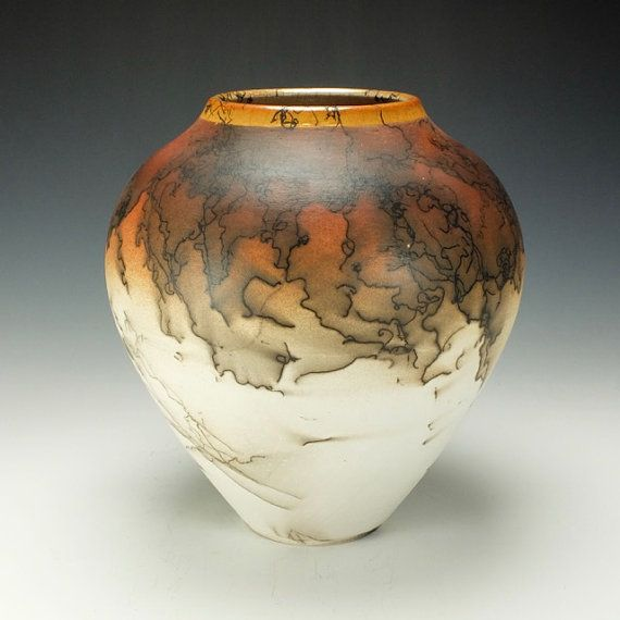 Wheel thrown stoneware Raku pottery vase. Raku fired with horse hair. Clear crackle glaze inside and on lip. Signed on the bottom by the artist. The images are of the actual piece for sale. This Raku piece is for decorative use only. The clay remains porous and is not suitable for