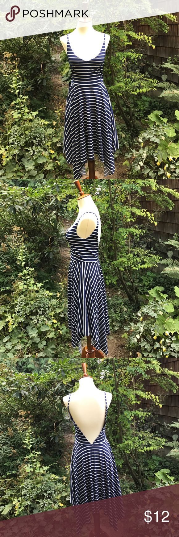Low back Striped Dress Pretty, nautical striped dress with low cut in both back and front. Very pretty on figure, but may need to be layered with the right camisole for added coverage. Great for dancing and nights out! Dresses Midi