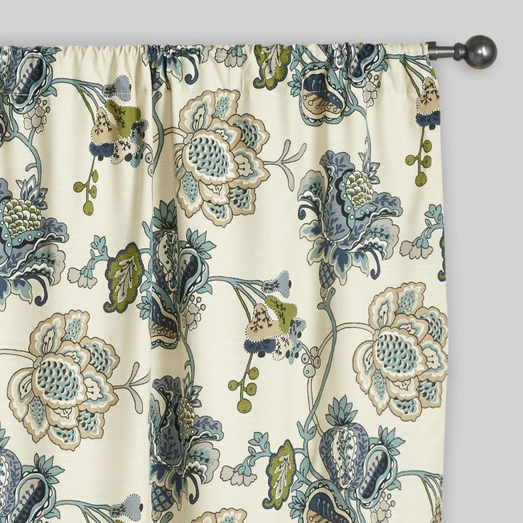 Our Floral Tatiana Sleevetop Curtain's medley of flowers and pods in hues of green, teal and blue bring a refreshing spring look to your bedroom. Featuring a nicely tailored sleeve top and fully lined construction, this curtain complements any space for the perfect price.