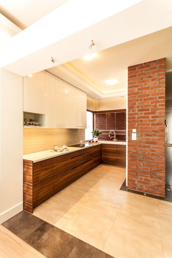 Aranżacja kuchni z ceglaną ścianą - Segment w Kwirynowie TISSU Architecture