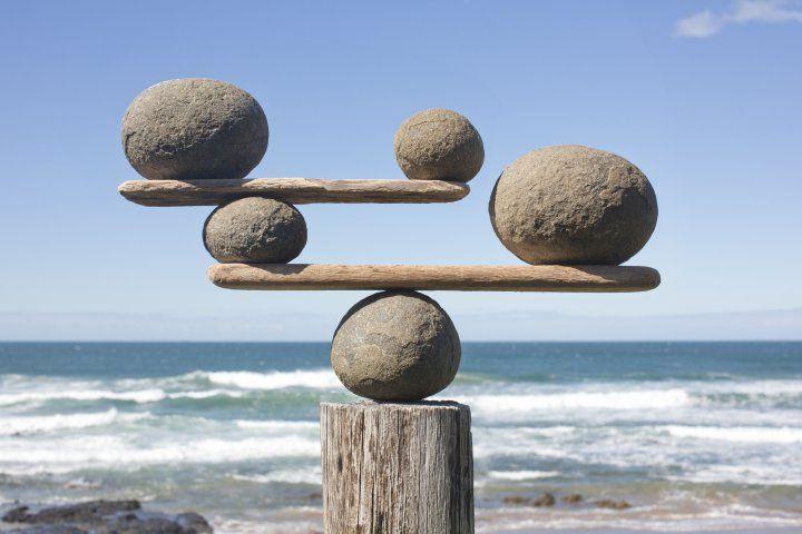 Balancing finances | Image source: Time.com