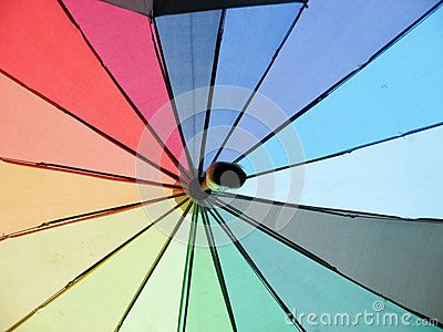 Image with colorful umbrellas suspended for background.