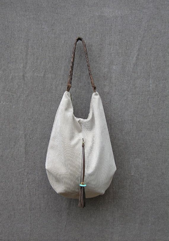 stone cnvas and Leather Tote is gorgeously soft to touch and super roomy - an extra large handbag. Large enough to fit all your daily needs - and more! It is lovingly handmade from canvas and genuine Italian leather, This hobo style bag features a handy external zipped pocket, a large fully lined main section, and a small interior zipped pocket. The strap is hand braided, sits comfortably on the shoulder and the external zipper puller is decorated with a turquoise stone. This leather tote is…