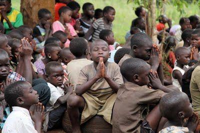 Uganda children praying.