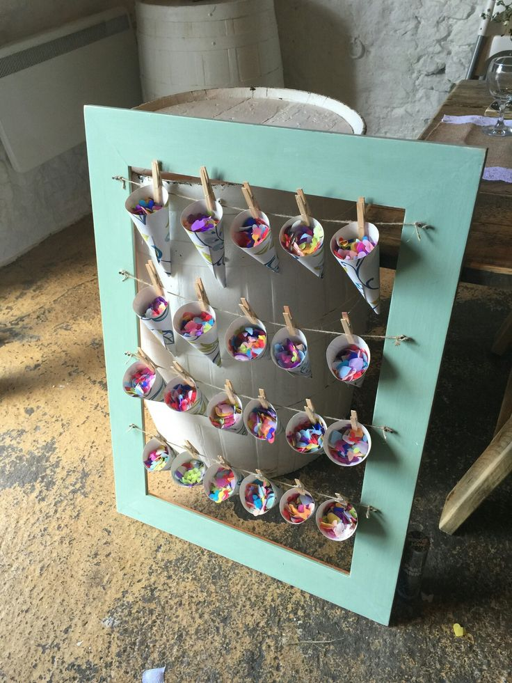 DIY from our own wedding at The Barn at Dalduff Farm. Photo frame and twine confetti holder. Confetti cones made from wallpaper.