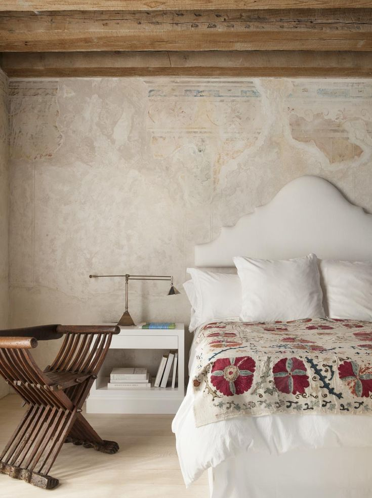 North of Malibu on a bluff overlooking Broad Beach, Richard Shapiro created a romantic villa with a splash of Mediterranean style. White suzani.