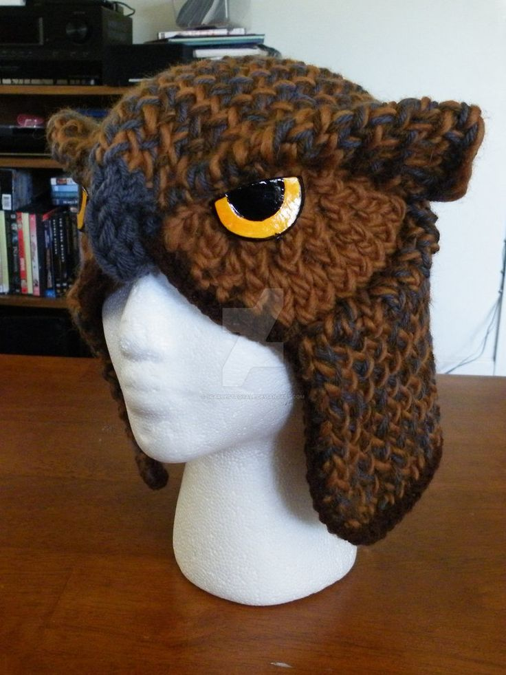 A realistic owl hat that has been loom knitted, and takes about 3 hours to make 1. But took me 3months to create the pattern. Want one? Check out this link to custom get one. scarlettroyale.webs.co...