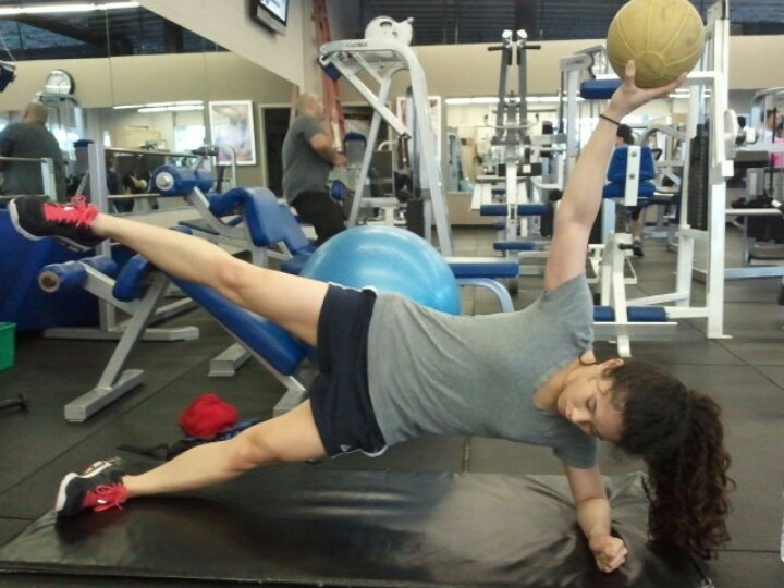 Lorelei side planking with a 10 lb medicine ball... Huah!