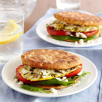 Start your day fresh and healthy. An egg, a slice of tomato, spinach leaves, and a sprinkle of feta packed onto a sandwich thin make for a light, protein-packed, and energy-boosting breakfast.