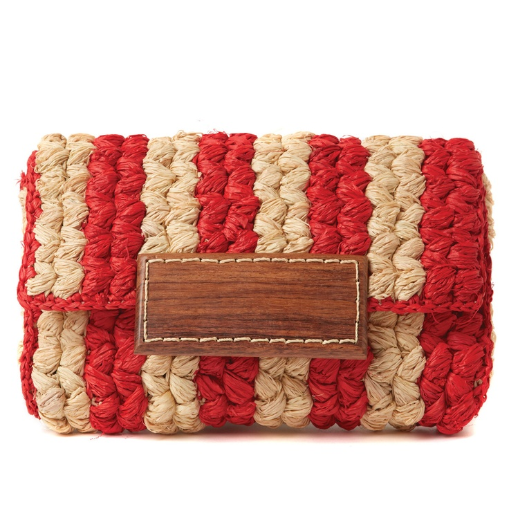 Handmade by Malagasy artisans dedicated to traditional craft and environmental conservation, Mar Y Sol's accessories lend their wearers a socially conscious slice of the sea and sun. A laid-back meeting of textured, braided raffia; bold, preppy-rustic stripes; and wooden details, the Remy Braided Clutch is beachside chic at its best.