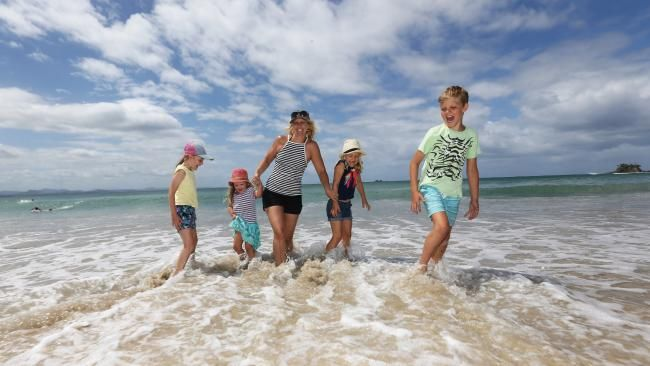 Staycation: Families getting more bang for their buck holidaying at home with rock bottom Aussie dollar and fuel prices