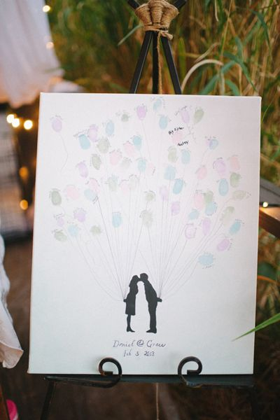 [Balloon thumbprint guest book] Have them stamp and sign their print instead of a traditional guest book. Would be so cute framed somewhere in the house! I've also seen it done as leaves on a tree