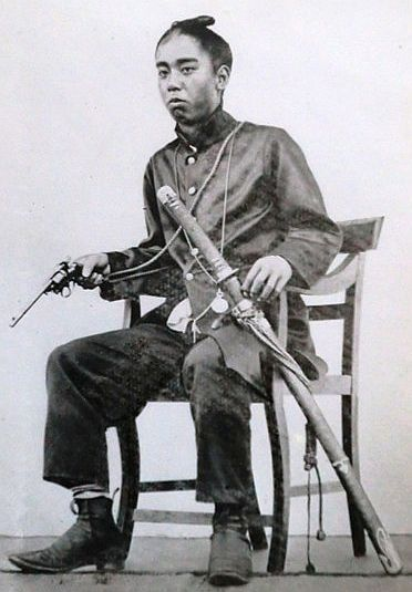 Mishima expresses xenophobic ideas in the novel and I assumed that his opinion was shared by most of Japan, especially its samurai warriors, so this photo of a samurai warrior with a Western style revolver surprises me. Maybe the samurai were not as opposed to foreign influence as Mishima was.