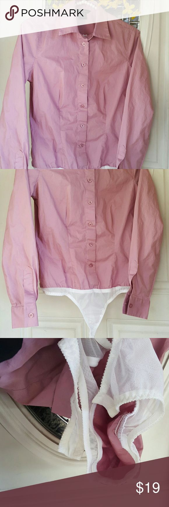ⓂVictoria Secret Moda international Bodysuit shirt ⓂVictoria Secret Bodysuit shirt Lilac/ Lavender color, long sleeve button down shirt with attached Bodysuit mesh panty snap on button,  so shirt won't come untucked, size Small. In like new condition, no stains no holes. Moda International Tops Button Down Shirts