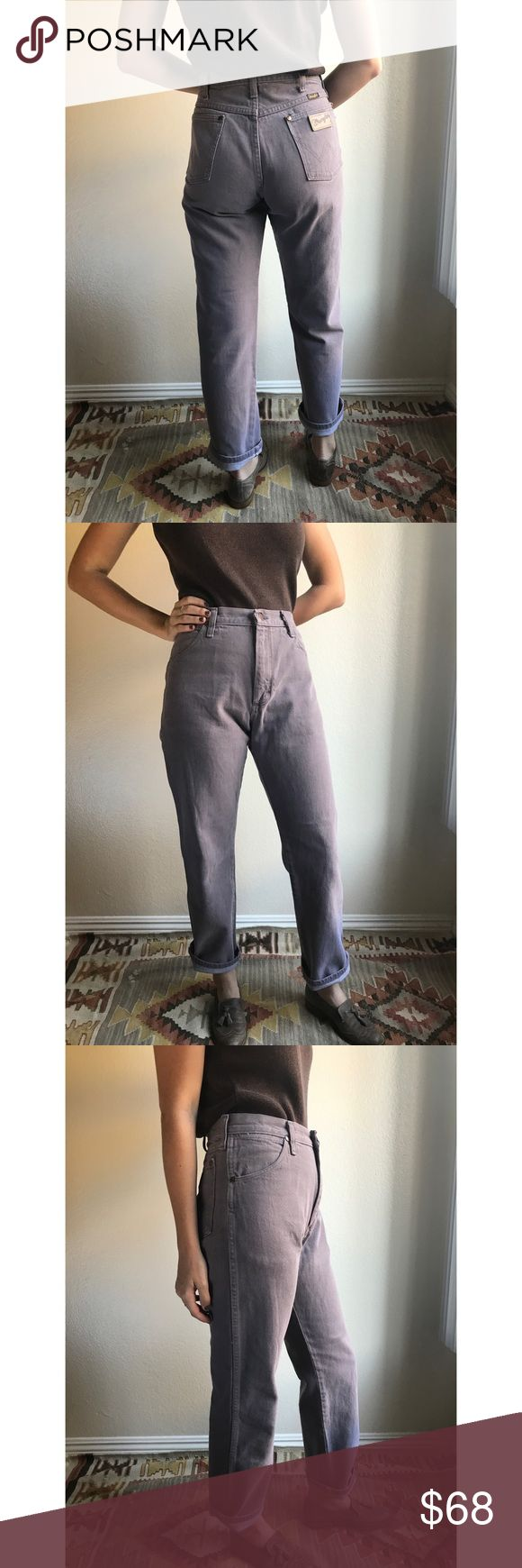 "[vintage] dusty purple Wrangler mom jeans So hard to let go of these, but they just don't fit anymore. Vintage Wrangler jeans with super high waist and classic bum patch styling. RARE dusty purple-grey color, I've never seen another, and in amazing condition with minimal distressing. Looks amazing with both gold/brown tones as well as black. Marked size 31/30, use measurements: waist 14.5"", rise 11"", hip 21"", inseam 29"". Let me know if you want a raw hem😍. Seen pinned on 5'6"" model with 26""…"
