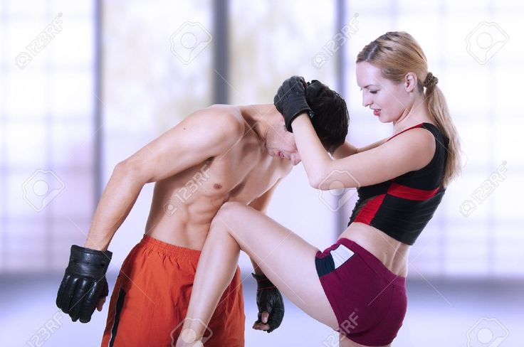 Female kicking knee a man in stomach