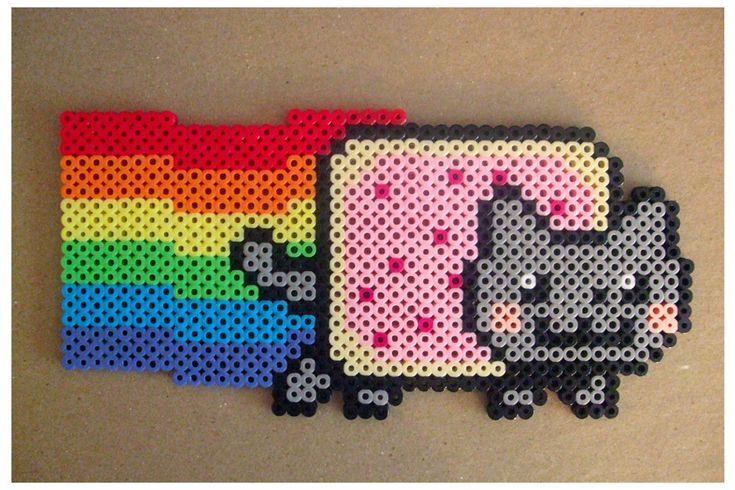 Nyan Cat Made from perler beads! This can be used for a cross stitch pattern and any cross stitch pattern can be used to make perler bead designs! Great easy any age craft!