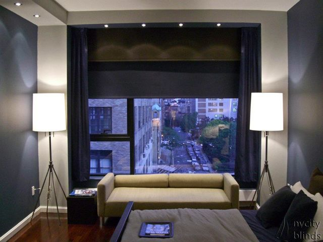 Custom motorized shades and curtains by NY City Blinds adorn this New York City studio apartment.